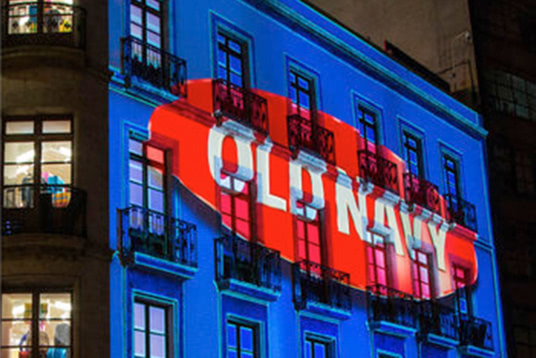 old navy logo projected on the side of a building