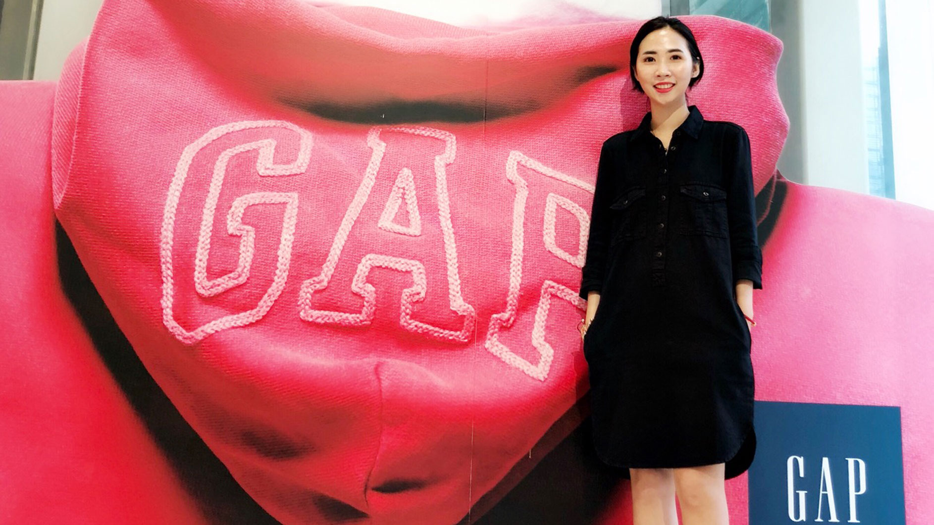 Constance Smiling in Front of Gap Logo